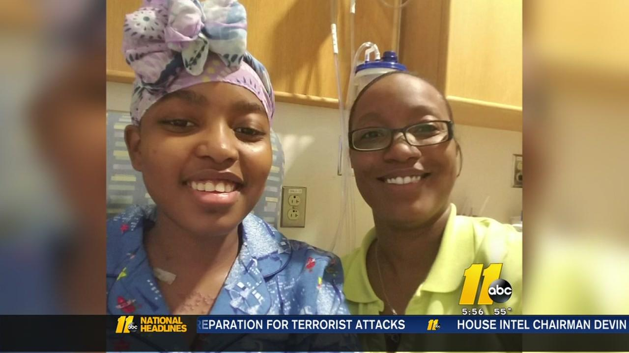 Nyasia Yarrell, left, has sickle cell and her younger sister Natalia Yarrell stepped in to help.