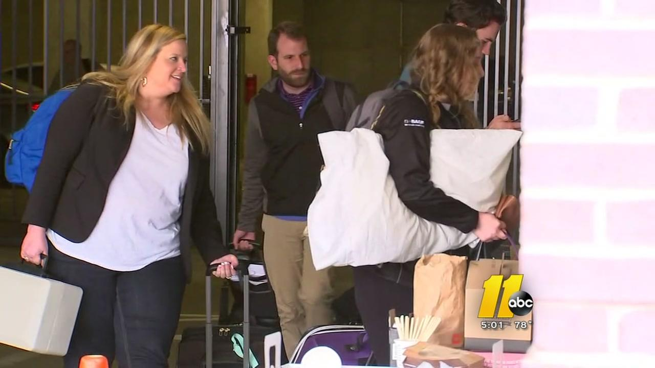 Displaced residents return home after fire