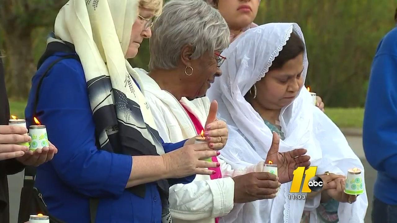 Nc residents hold vigil for victims of Syrian airstrike