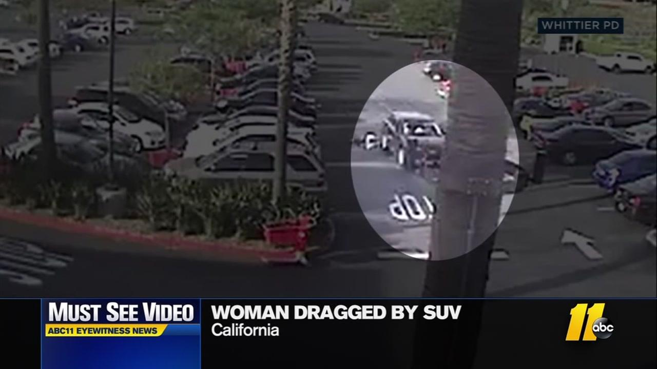 Woman dragged by SUV