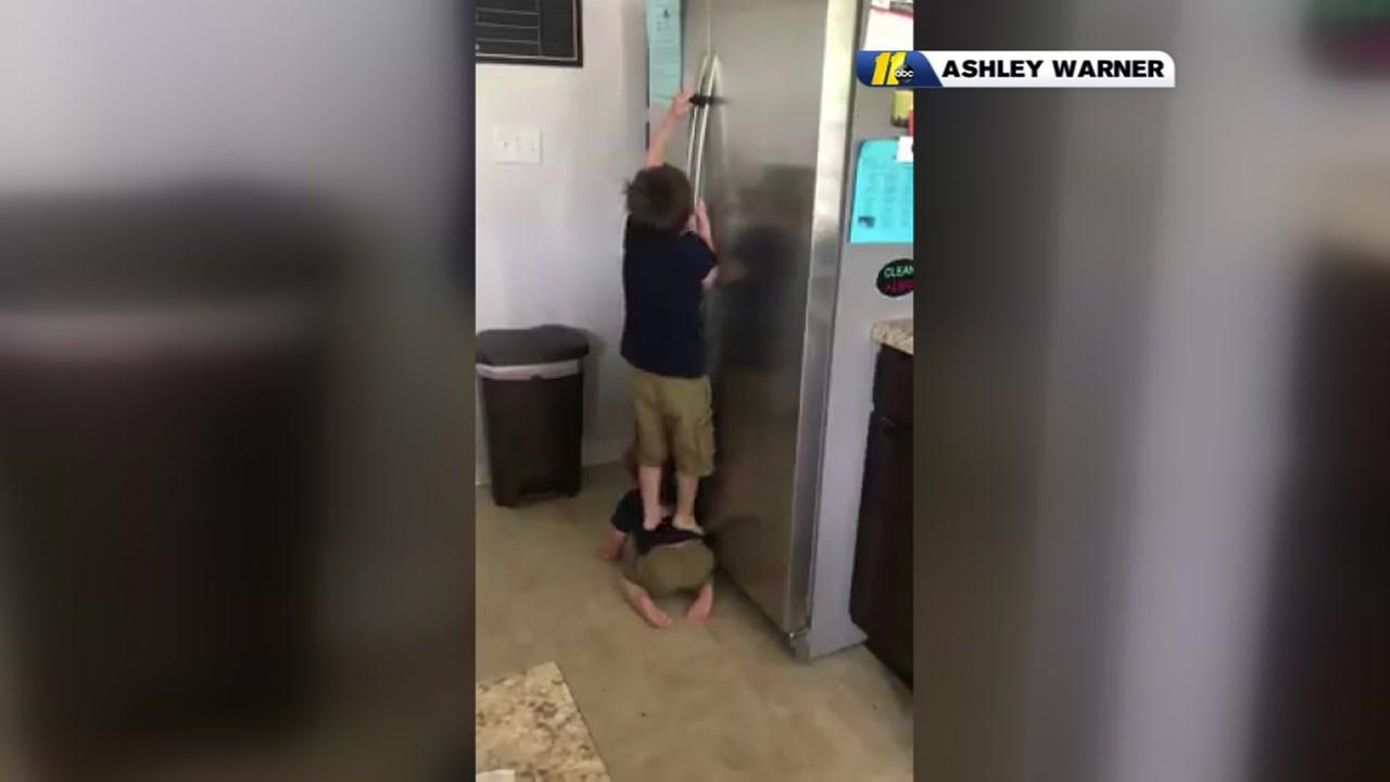Brothers team up to open locked fridge