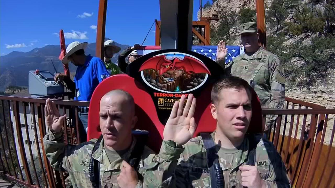 Colorado soldiers reenlist in the Army on free-fall ride at amusement park