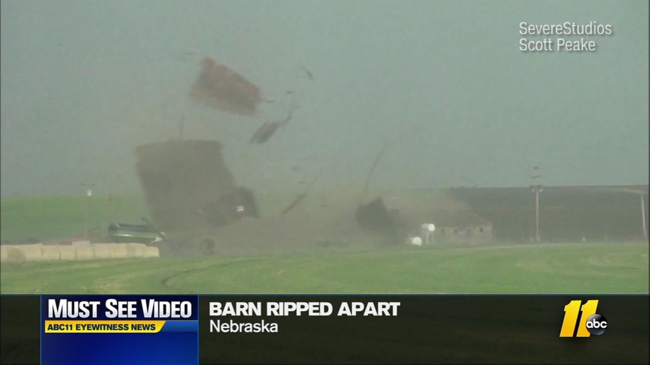 A twister rips a barn apart