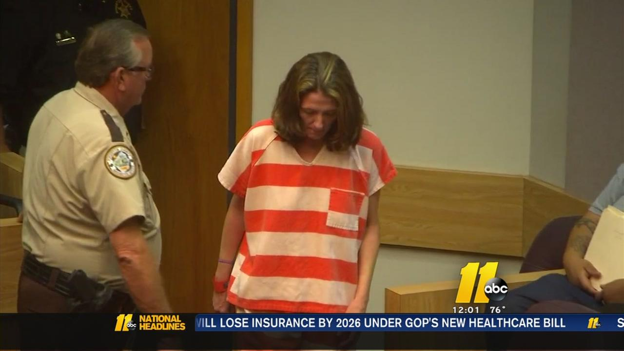 Mother accused of hiding dead childrens bodies under house appears in court