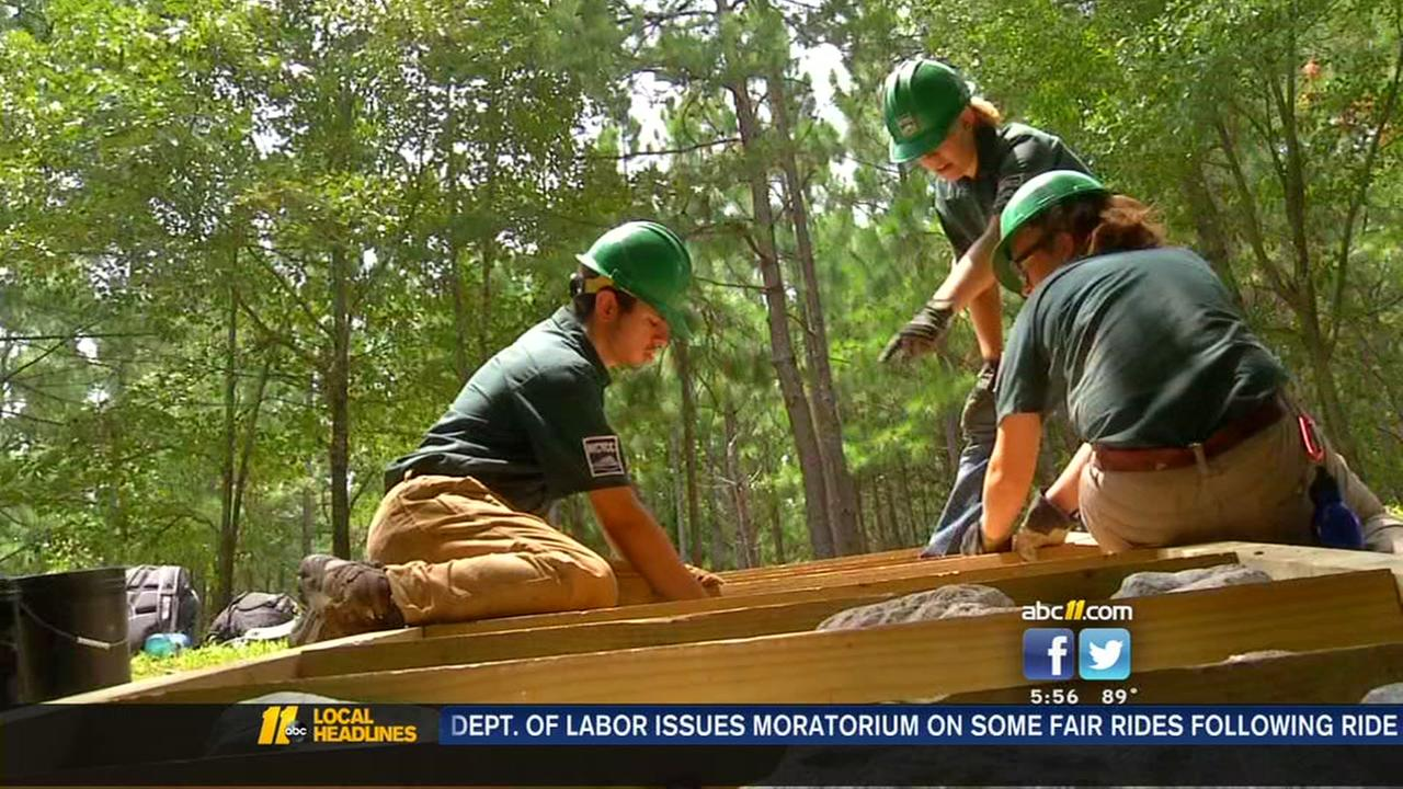 Teens give back by cleaning, enhancing lakes