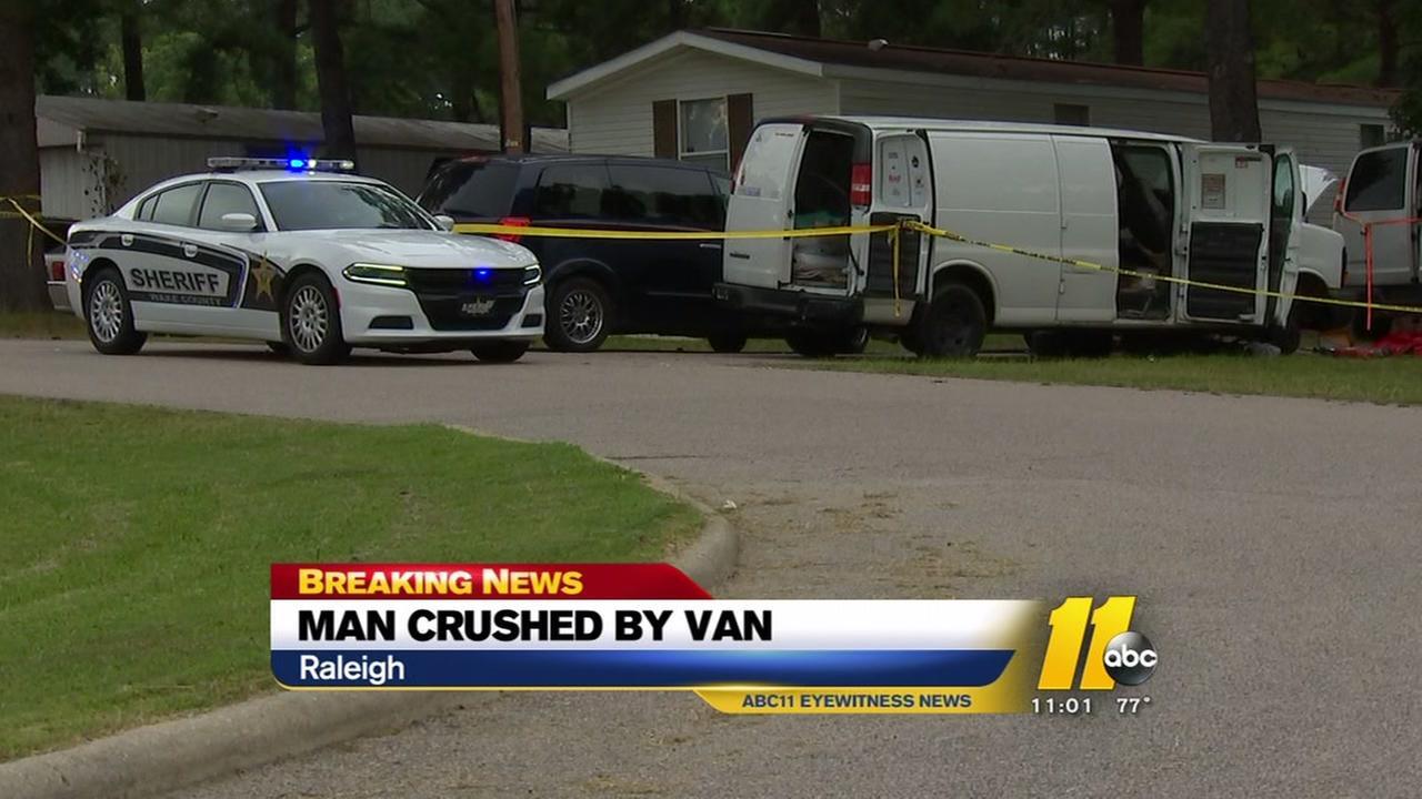 Van dies after van falls on him