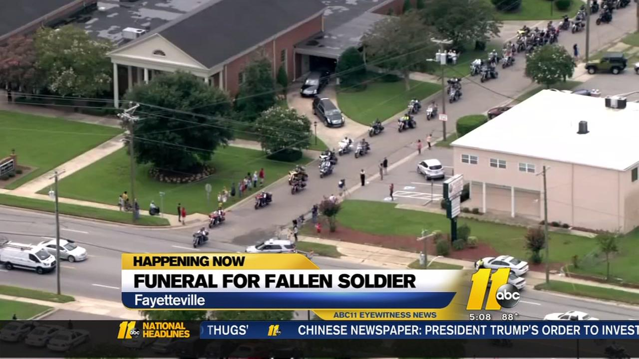 Thousands pay tribute to fallen soldier
