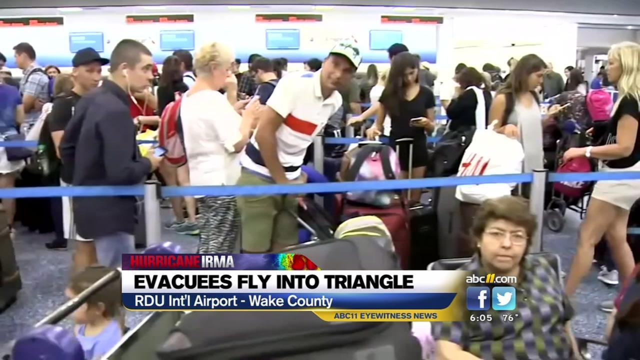 Evacuees fly into RDU