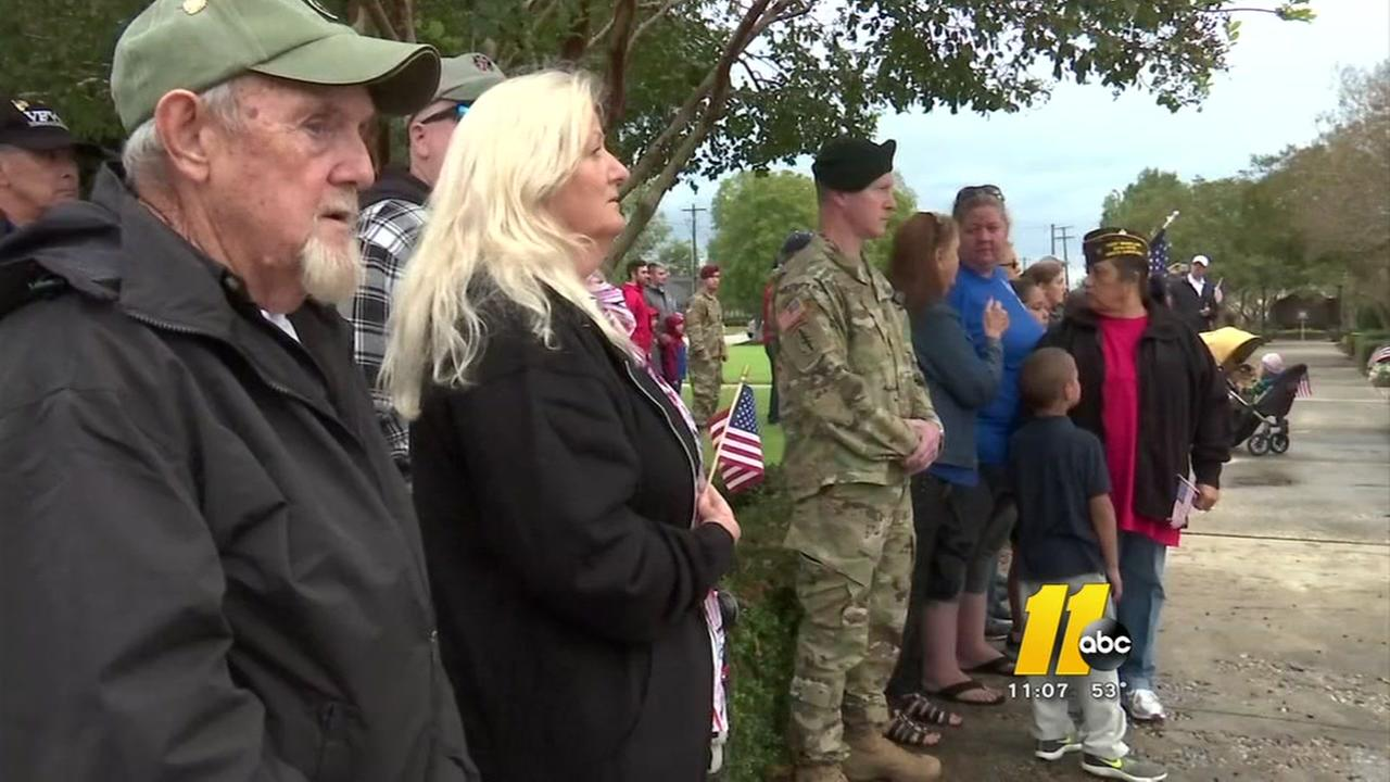 The streets were lined as people pay respects to the fallen soldiers