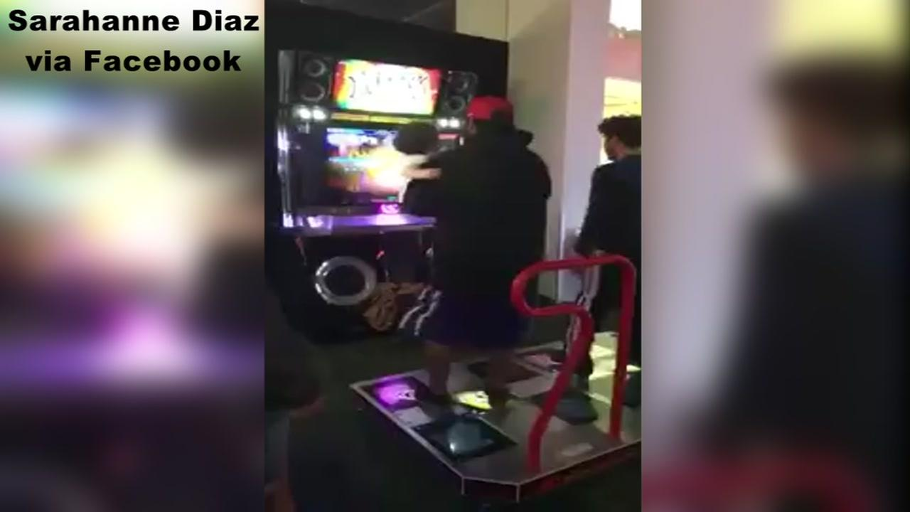 Daddy and daughter bust a move at Cary Dave and Busters