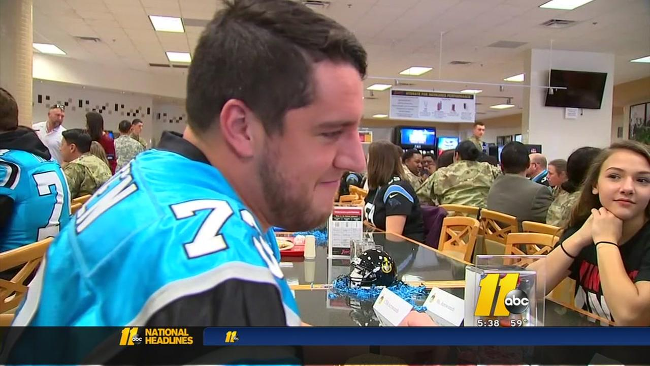 Carolina Panthers players meet with Fort Bragg families