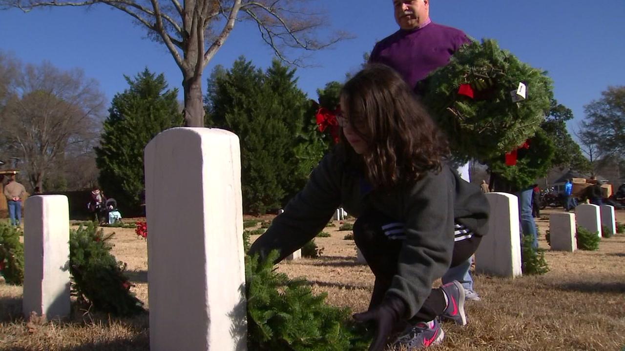 Hundreds gather at cemeteries for Lay a Wreath Day