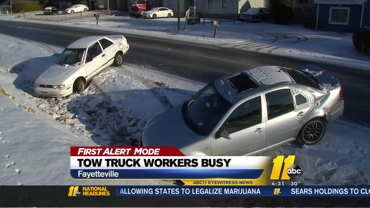 Tow truck drivers busy during snow storm