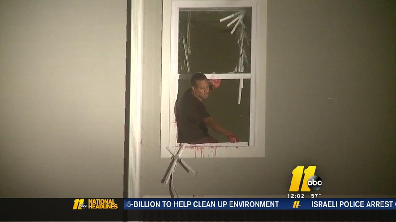 Armed Durham man hangs out third-story window, rants about black oppression