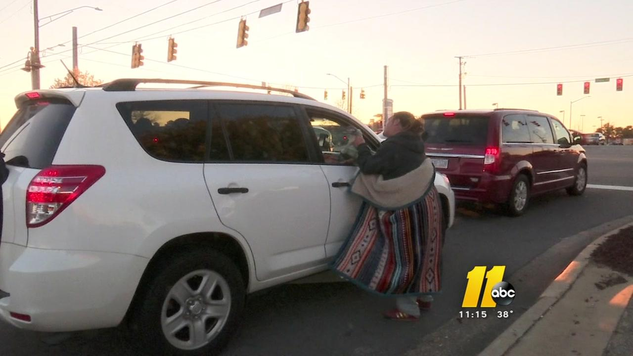 Fayetteville considers ban on money to the homeless