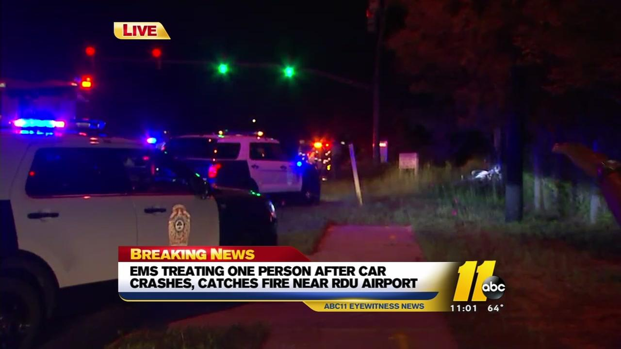 Woman injured in crash, car fire