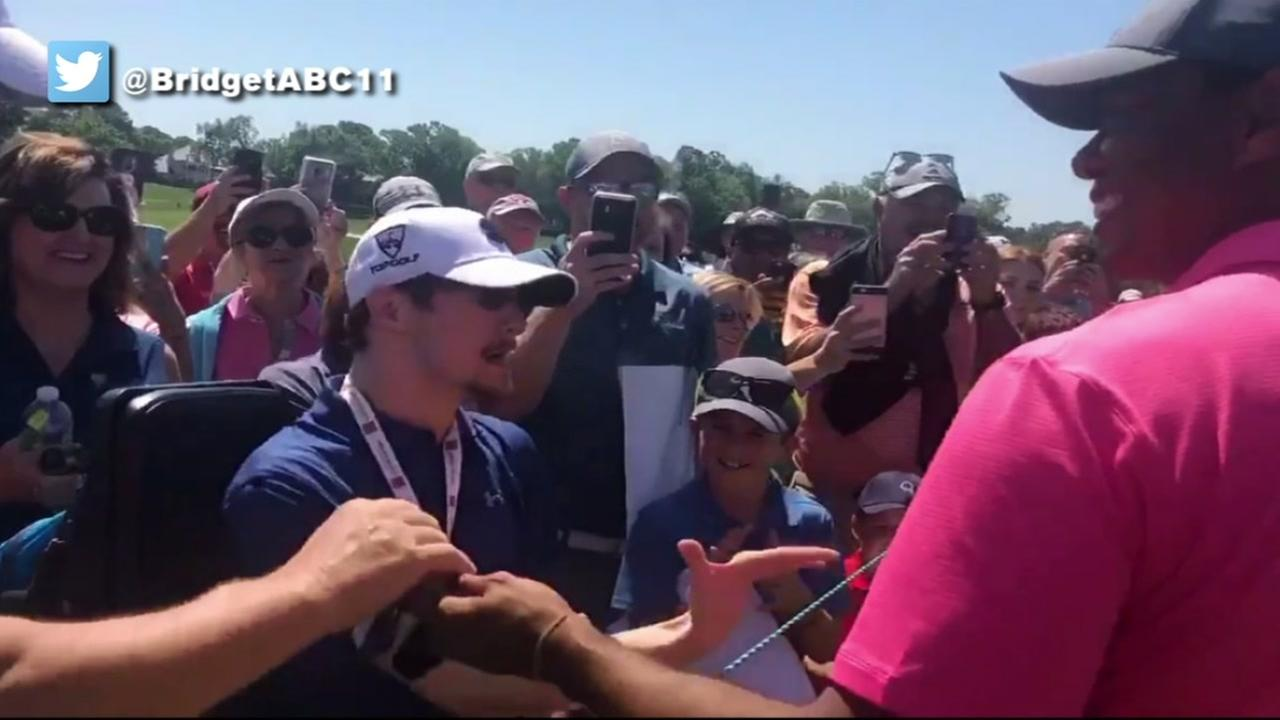 Tiger Woods greets one of his biggest fans while he plays at Quail Hollow in Charlotte