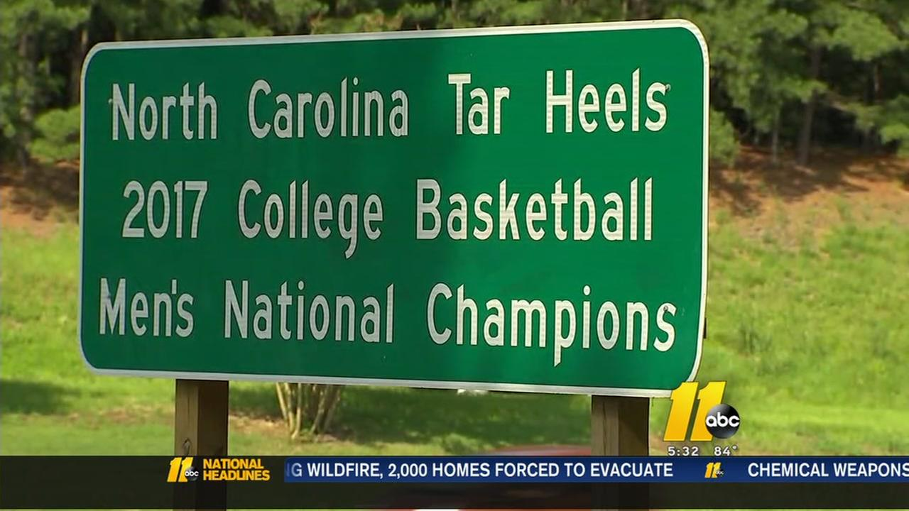 DOT officials install new sign for UNCs National Championship