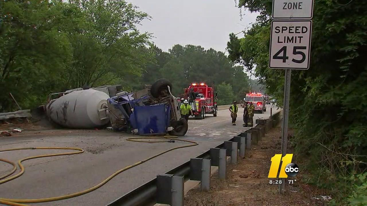 Cement truck overturns on Rock Quarry Road bridge over I-40 in Raleigh