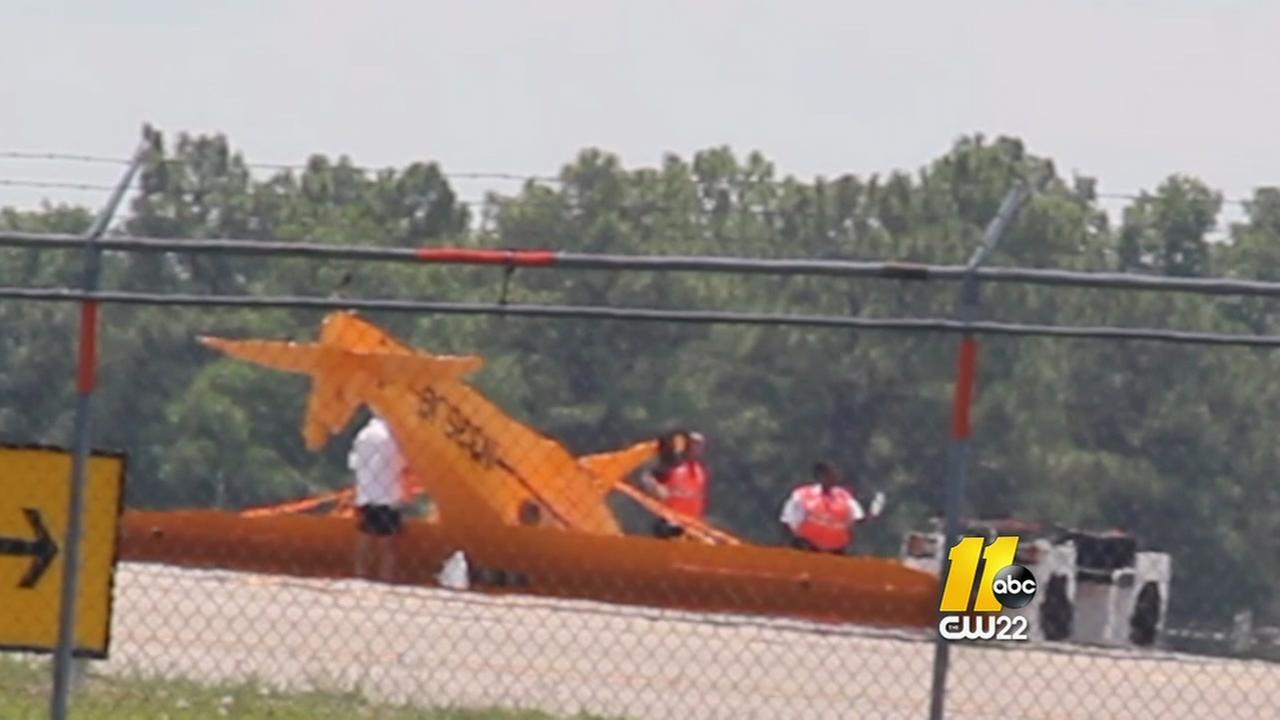 Plane flips at Fayettevill Regional Airport
