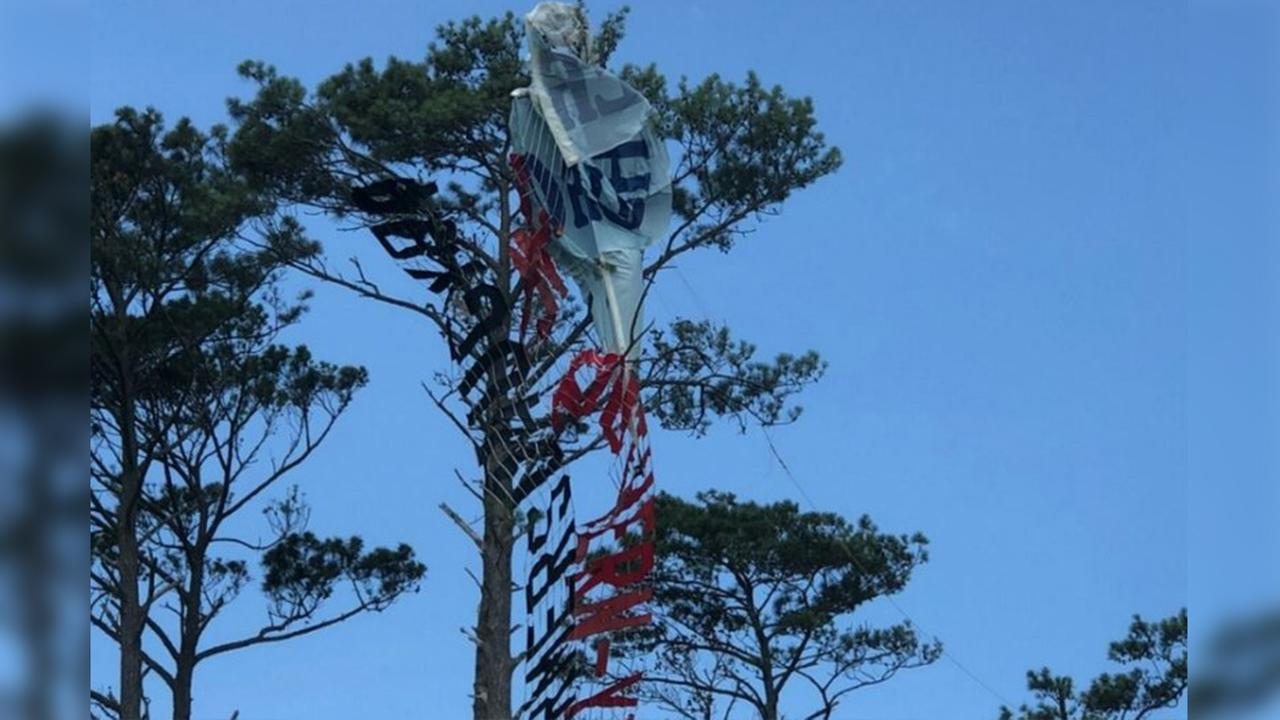 Pilot killed when plane towing banner gets tangled in trees in Outer Banks