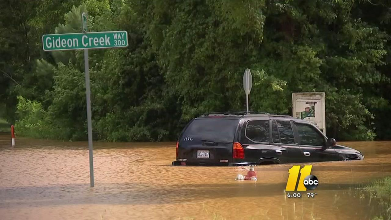 Driver rescued after being stranded on flooded SUV
