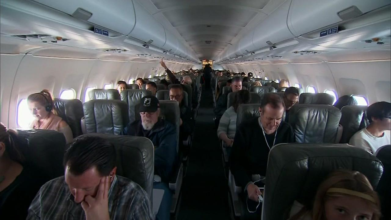 Tall people rejoice: Airline seats may not be getting any smaller.