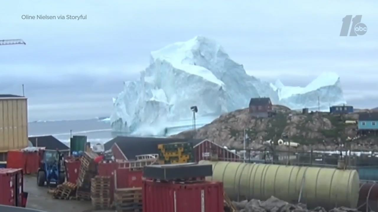 Watch: 300-foot iceberg floats near Greenland village