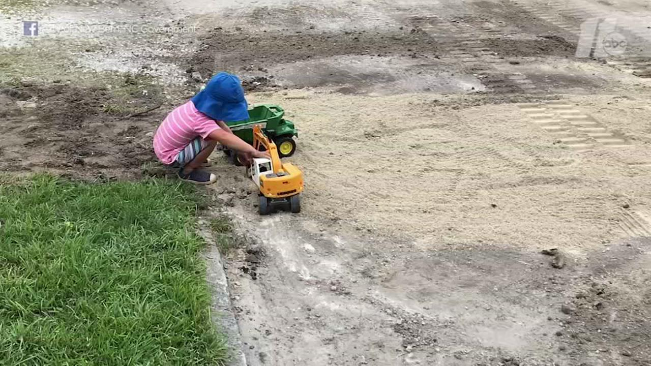 New Bern toddler loves playing with trucks near construction site