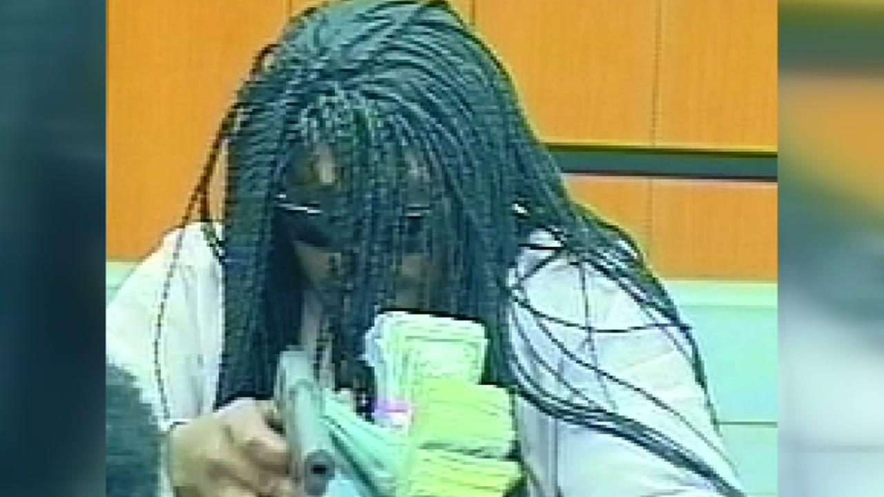 Surveillance photos released of man accused of shooting bank teller in Durham