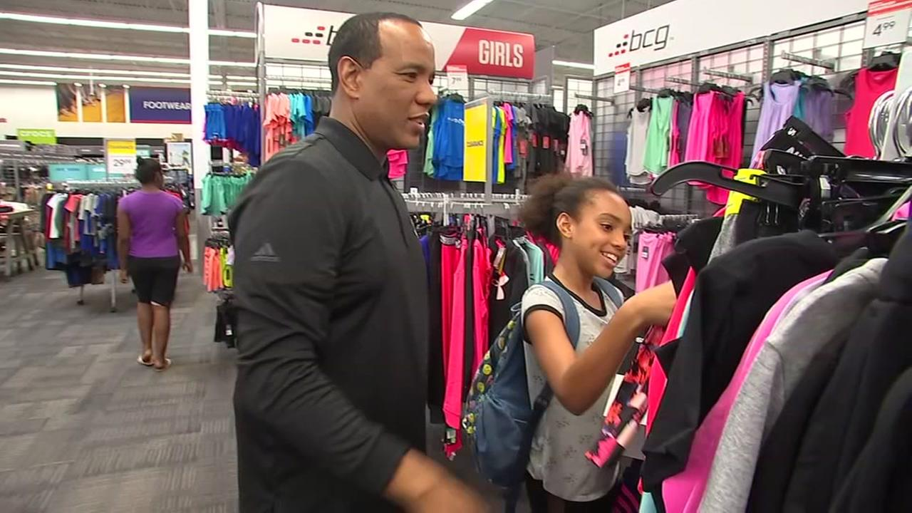 NC State coach Keatts accompanies kids on back-to-schol shopping spree