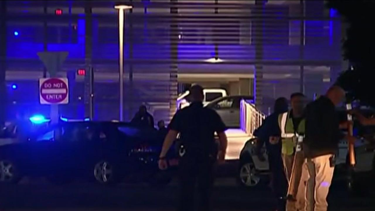 Charlotte officer fires at driver who nearly ran him over at airport