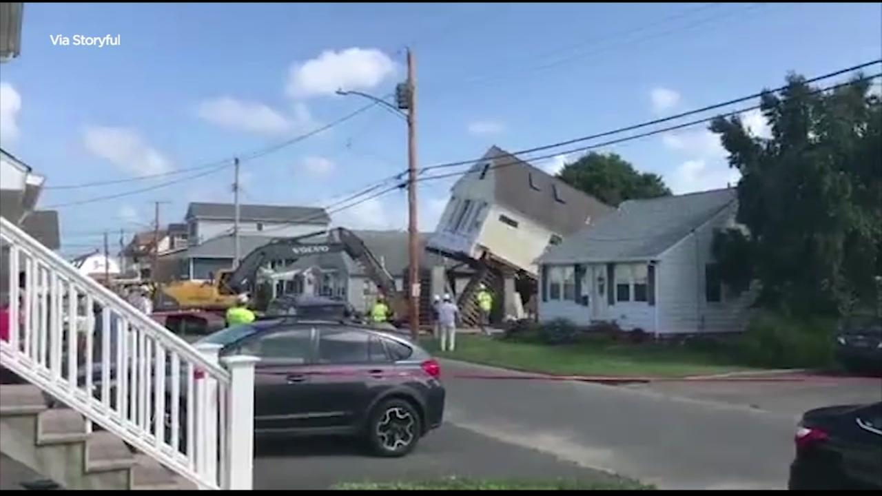 WATCH: House raising quickly becomes house demolition
