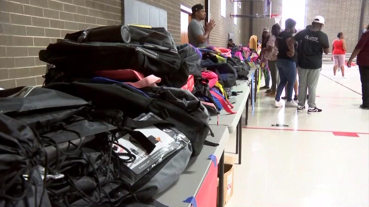 Women That Care give backpacks to children in need
