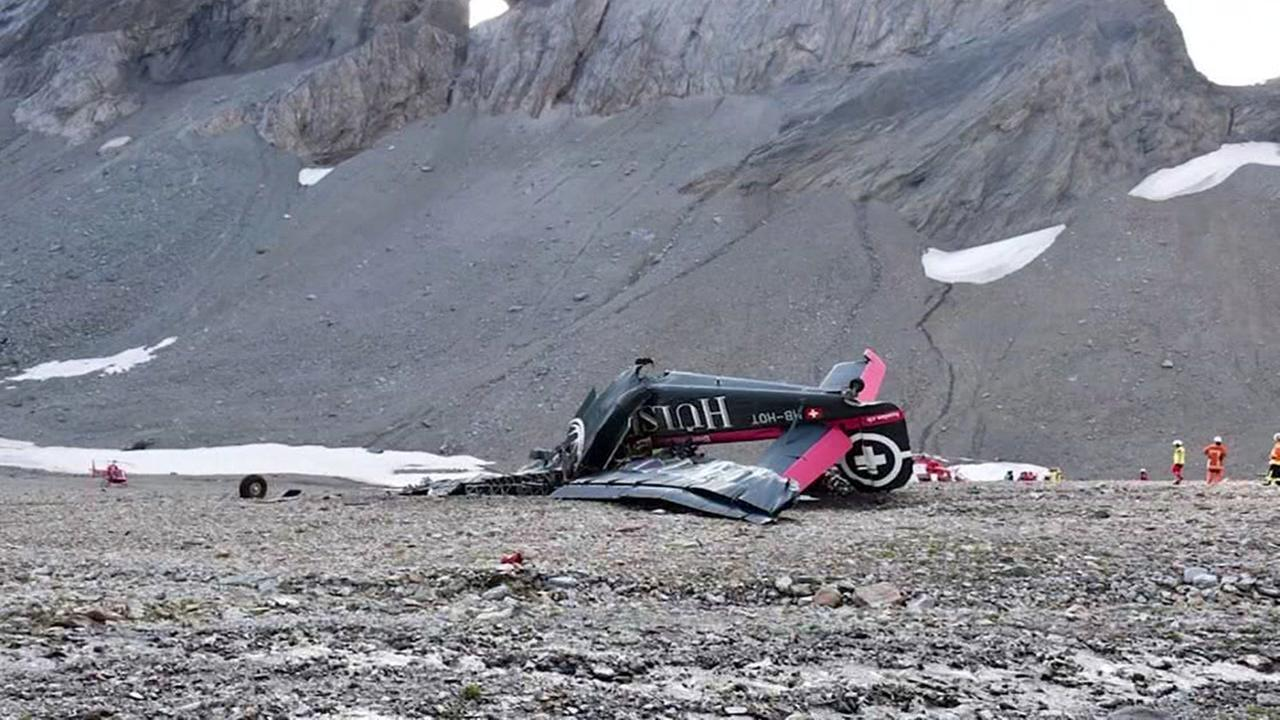 Vintage plane crashes in Swiss Alps, killing 20 on board