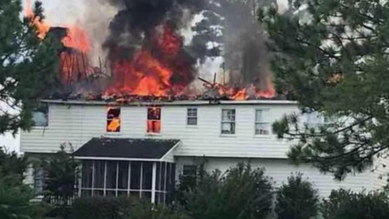 Two families are burned out of their homes after lightning strikes sparked fires.