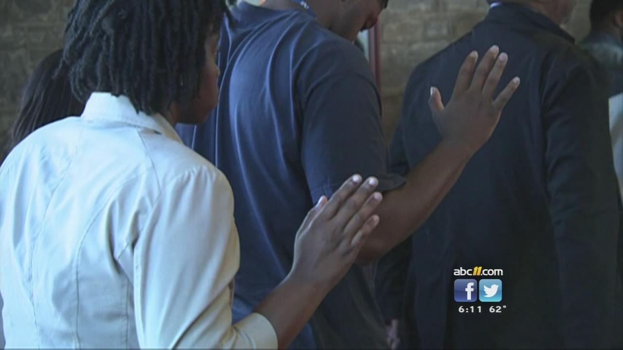 Saint Augs students attend vigil for Michael Brown, Ferguson