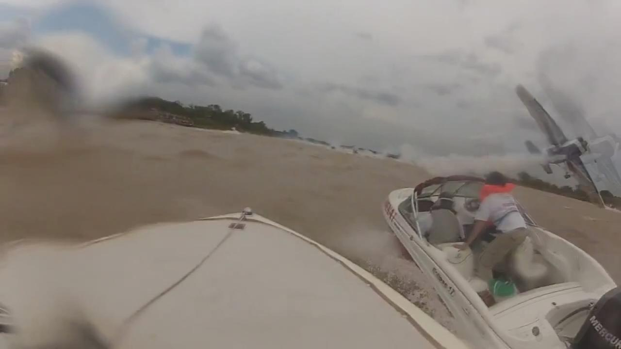 Plane flies dangerously close to boat in close call video