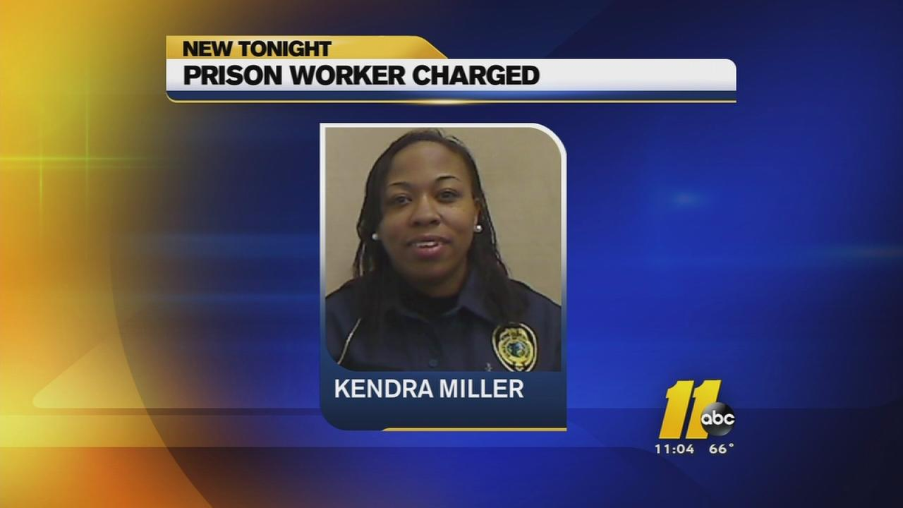 Worker charged for helping inmate