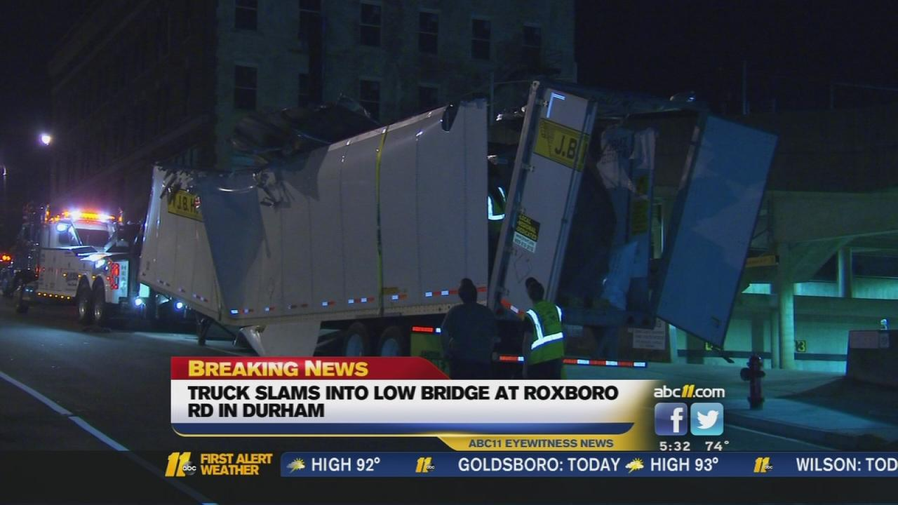 Truck slams into Durham bridge