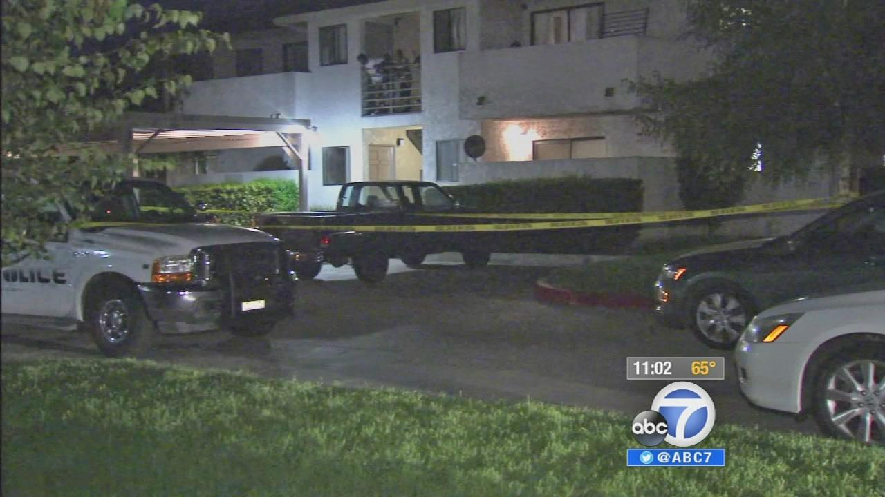 Authorities investigate a murder scene in Fontana on Tuesday, Aug. 20, 2013.