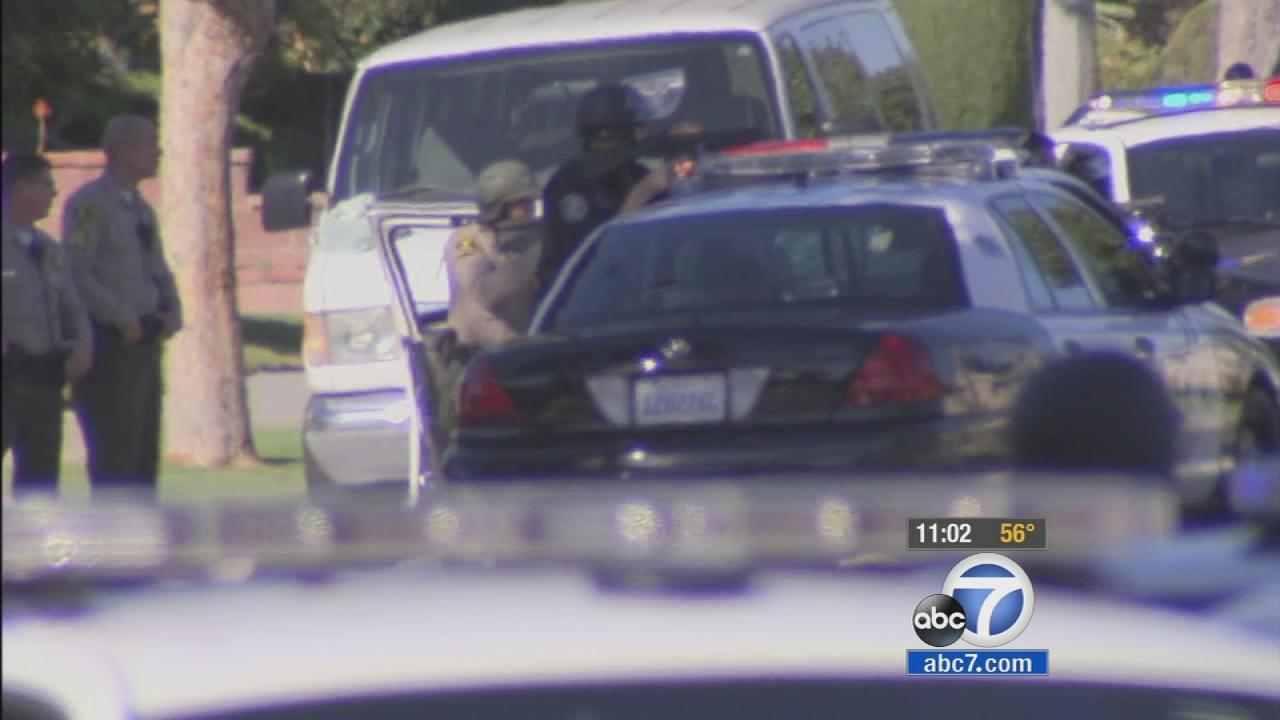 A gunman was barricaded inside an Inglewood home with two hostages after opening fire on police on Wednesday, Nov. 27, 2013.