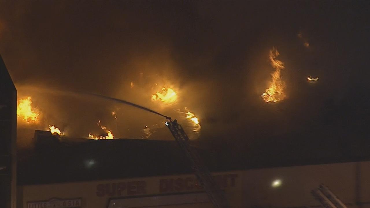 Firefighters battled a fire at a strip mall in Hawthorne Wednesday, Dec. 18, 2013.