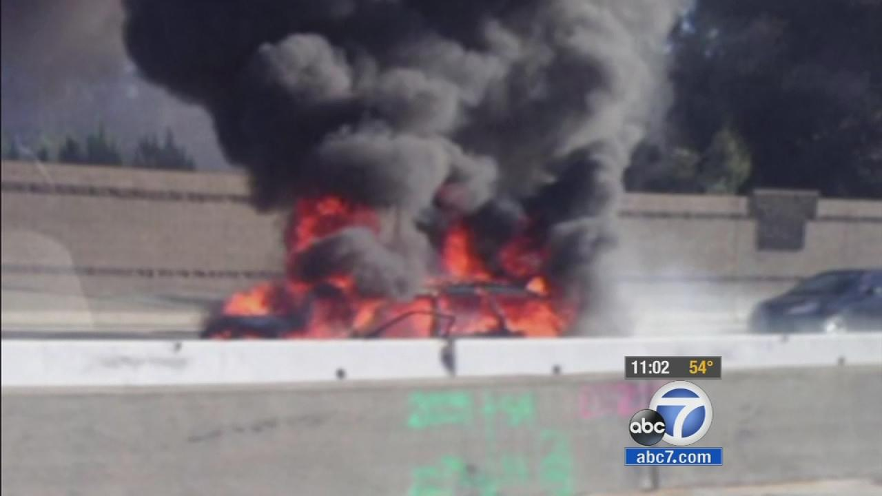 An LAPD Bomb Squad officer rescued a man from a burning car on the 405 Freeway Christmas Day.