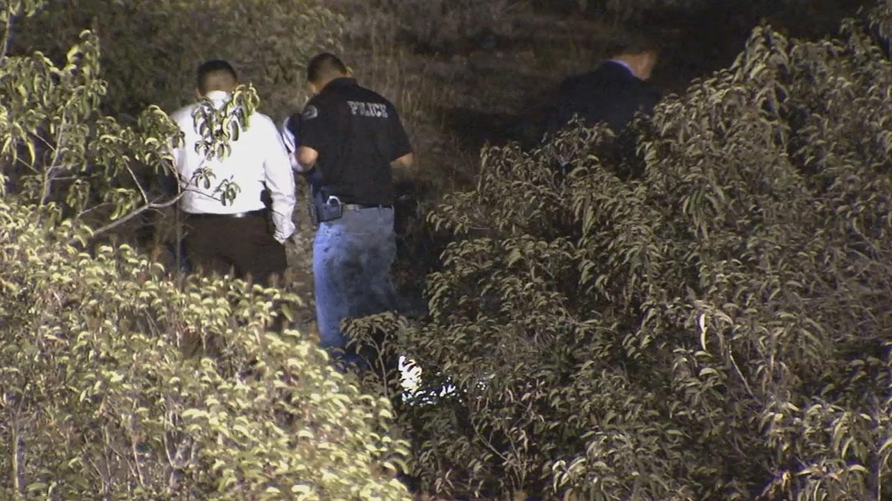 Authorities investigate in Irwindale after a headless human body was found on Thursday, Feb. 13, 2014.