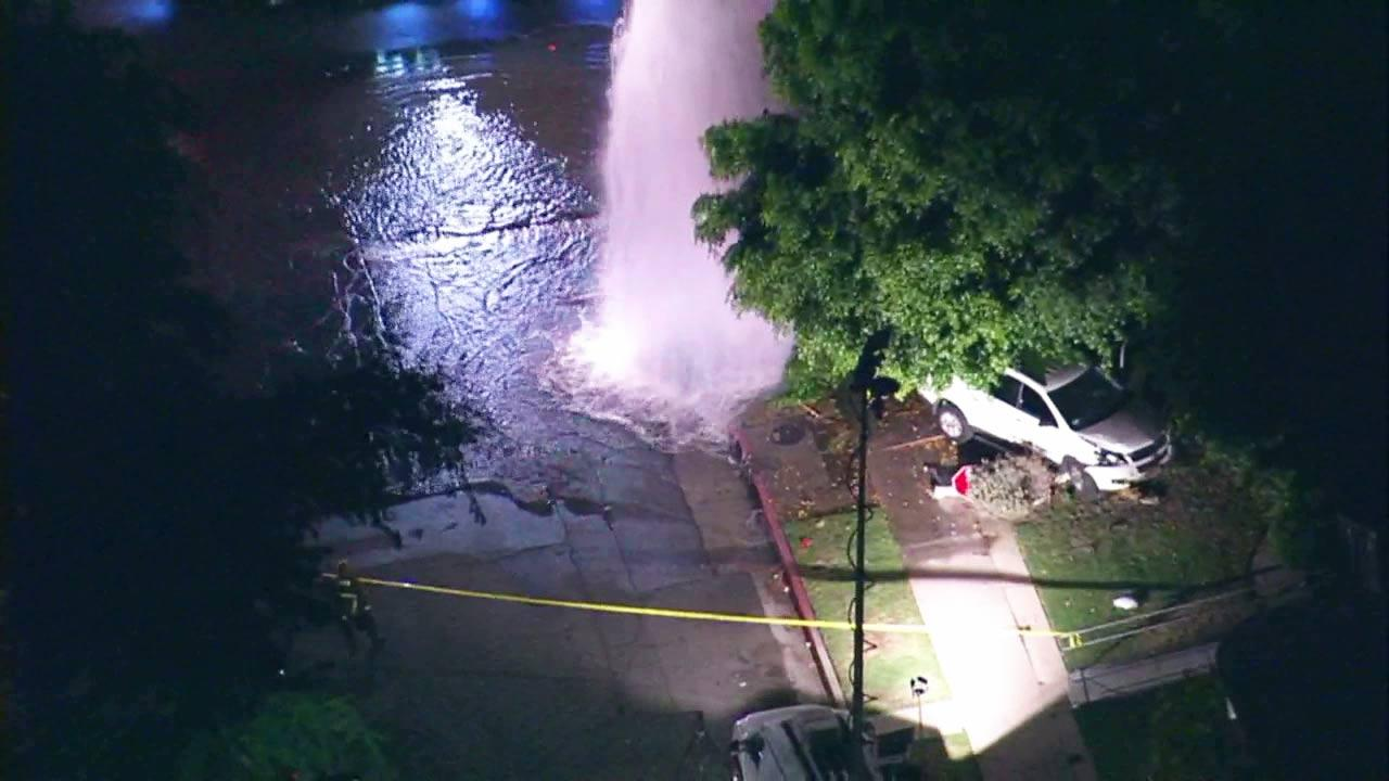The driver of a white SUV plowed into a fire hydrant and power pole in Valley Village on Wednesday, Aug. 22, 2012. Two Good Samaritans were killed trying to help the driver.
