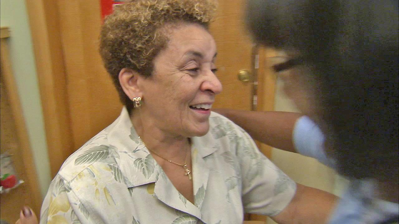 Linda Fairfax (left) is seen as she is about to hug her friend, Carol Walker (right), who gave her $500 from ABC7s Pay It Forward.
