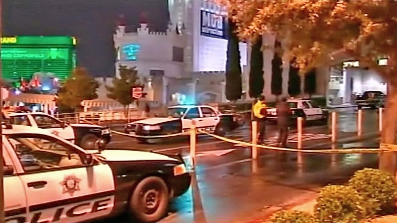 Police are seen outside the Excalibur hotel after an apparent murder-suicide that left a man and a woman dead on Friday, Dec. 14, 2012.