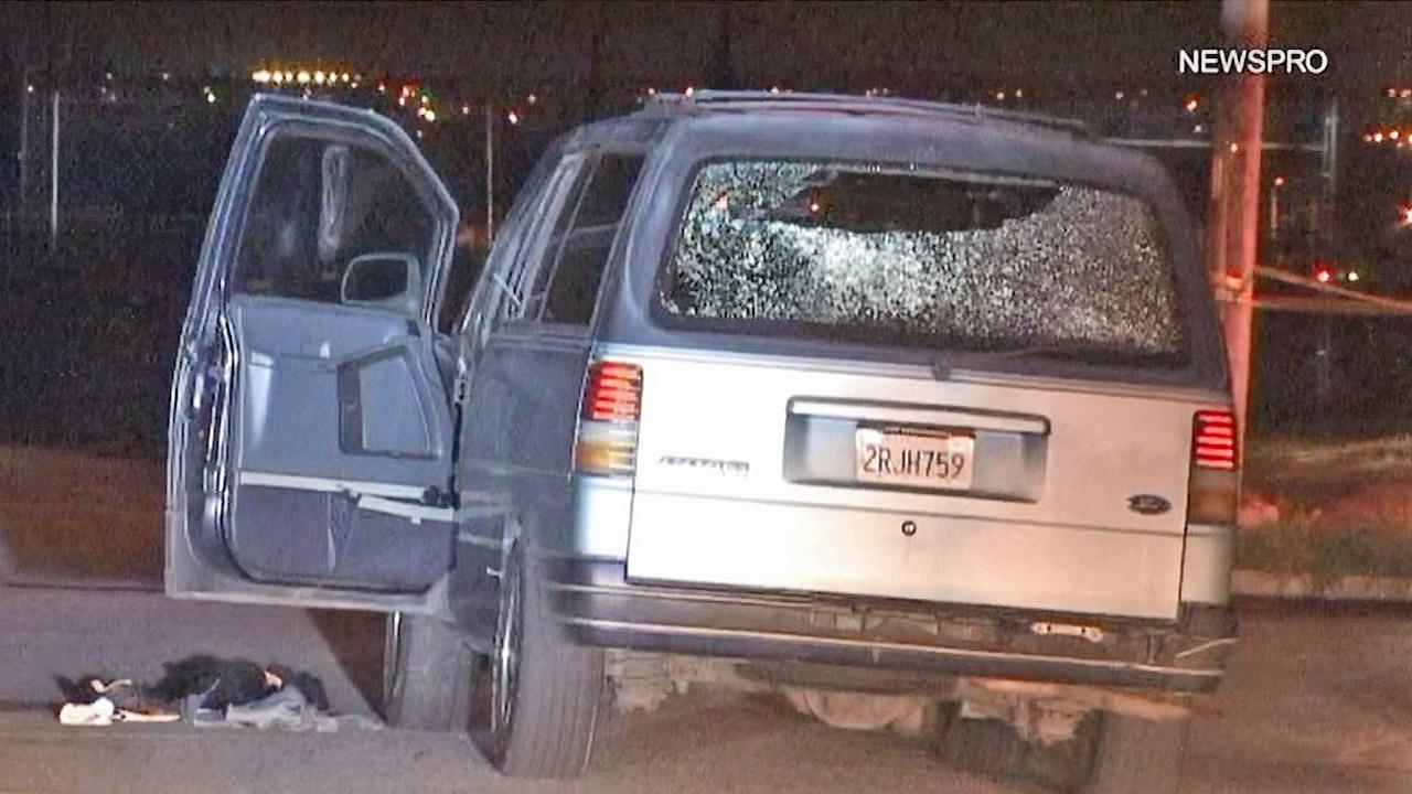 The back window of a van is seen after an alleged exchange of gunfire between the driver and deputies in Highland on Monday, Dec. 31, 2012. The driver was hospitalized and is expected to survive. He is facing charges.