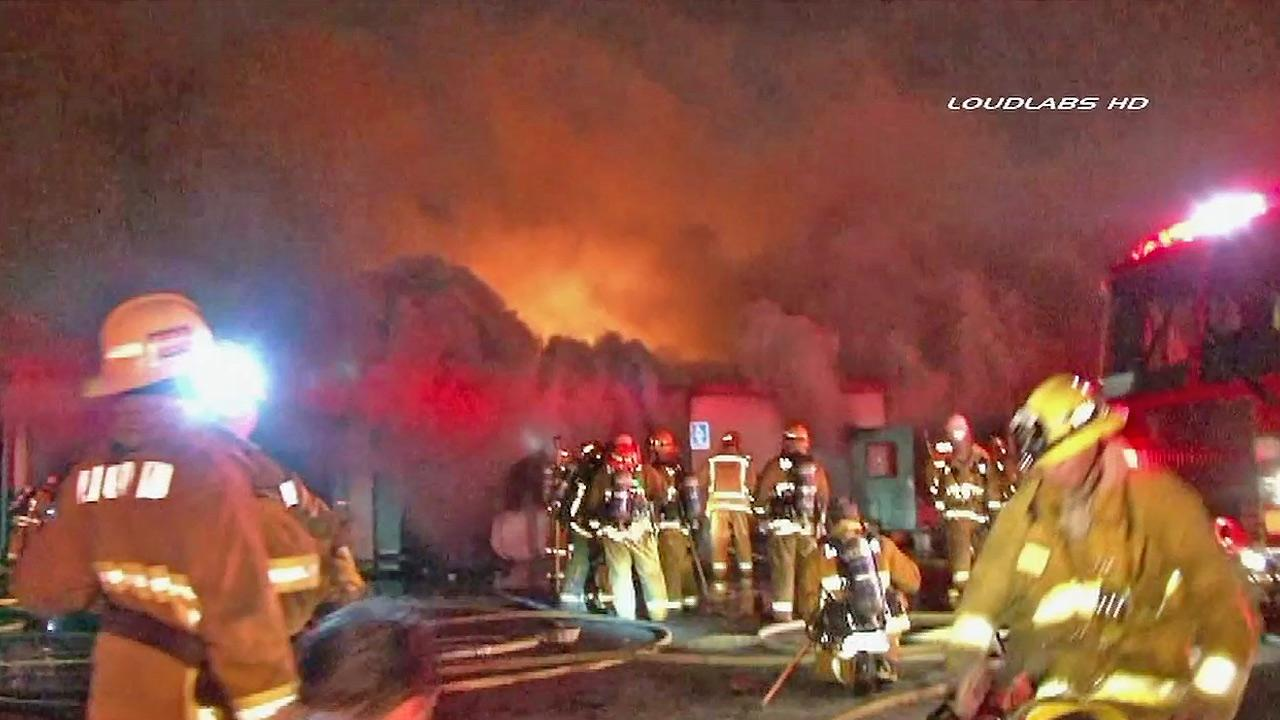 Firefighters are seen battling a fire at a storage facility in Gardena on Sunday, Feb. 17, 2013.